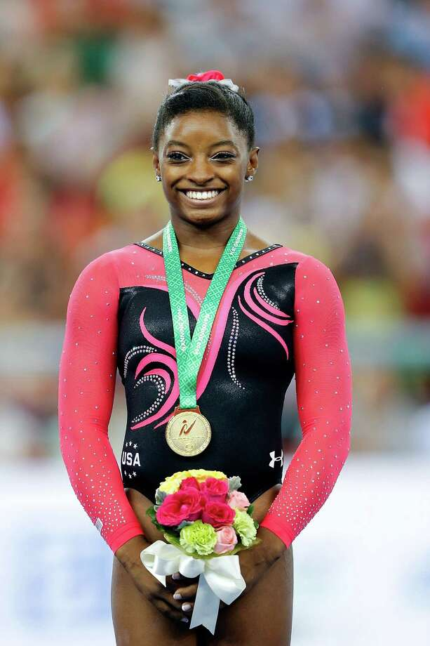 NANNING, CHINA - OCTOBER 12:  Gold medalist Simone Biles of United States celebrates during the medal ceremony after Women's Balance Beam Final on day six of the 45th Artistic Gymnastics World Championships at Guangxi Sports Center Stadium on October 12, 2014 in Nanning, China. Photo: Lintao Zhang, Getty Images / 2014 Getty Images