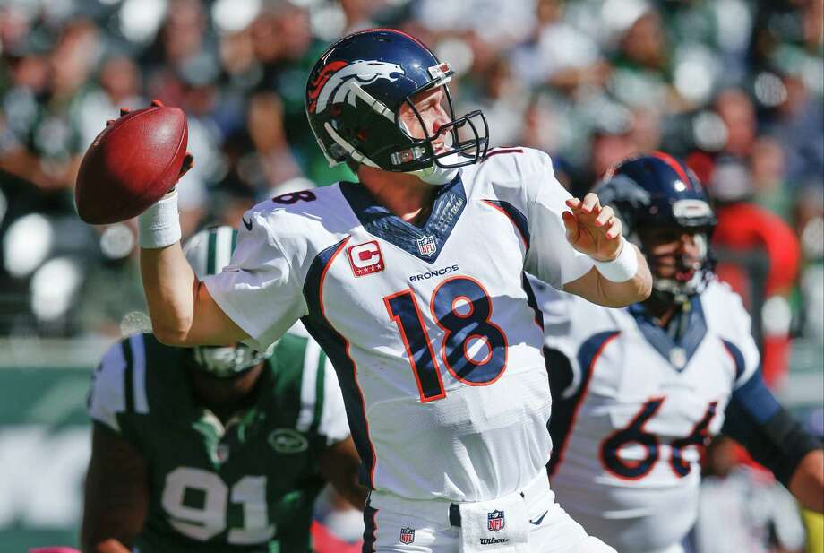 Denver Broncos quarterback Peyton Manning (18) throws against the New York Jets in the first quarter of an NFL football game, Sunday, Oct. 12, 2014, in East Rutherford, N.J. (AP Photo/Kathy Willens)  ORG XMIT: ERU101 Photo: Kathy Willens / AP