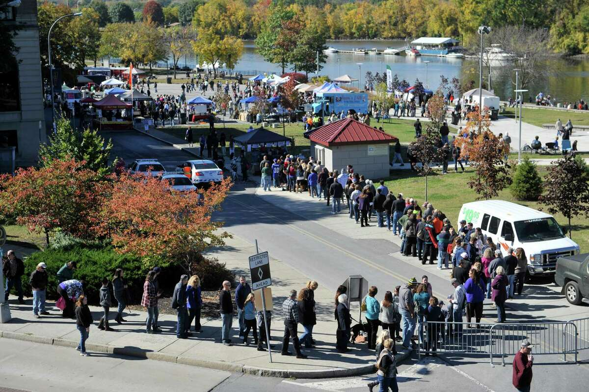People stand in line along River St. to get tickets for the eighth annual Chowderfest at Riverfront Park on Sunday, Oct. 12, 2014, in Troy, N.Y. (Paul Buckowski / Times Union)