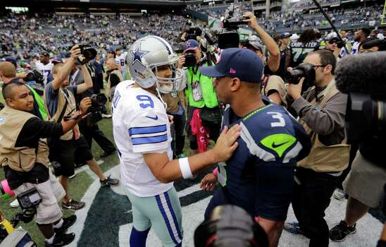 Dallas Cowboys quarterback Tony Romo (9) greets Seattle Seahawks quarterback Russell Wilson after an NFL football game, Sunday, Oct. 12, 2014, in Seattle. Dallas won 30-23. (AP Photo/Scott Eklund) Photo: Scott Eklund, Associated Press / FR159797 AP