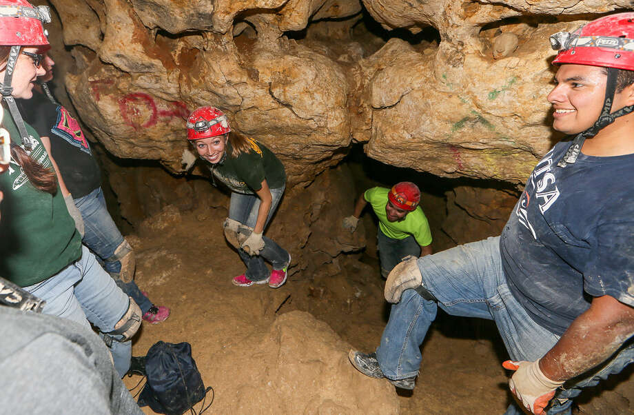 Students from the Mechanical Engineering Department at UTSA climb through a passageway of the Robber Baron Cave. The students are developing equipment for cave divers to measure high levels of CO                   {-2} found in the cave. Photo: Marvin Pfeiffer / San Antonio Express-News / EN Communities 2014