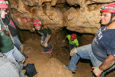 Students from the Mechanical Engineering Department at UTSA climb through a passageway of the Robber Baron Cave. The students are developing equipment for cave divers to measure high levels of CO                   {-2} found in the cave.