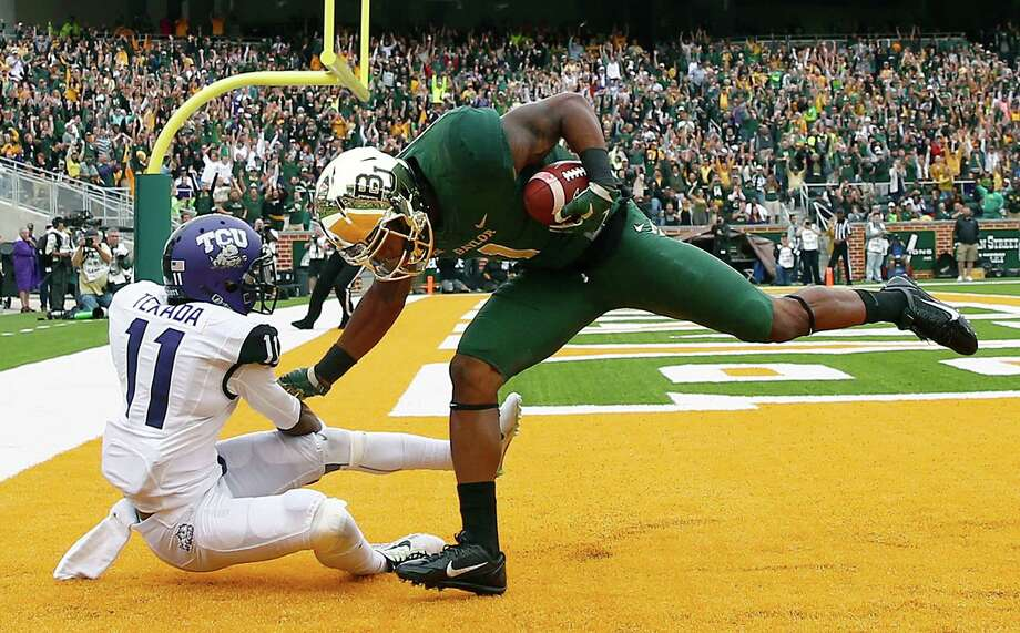 WACO, TX - OCTOBER 11:  Corey Coleman #1 of the Baylor Bears scores a touchdown against Ranthony Texada #11 of the TCU Horned Frogs in the first half at McLane Stadium on October 11, 2014 in Waco, Texas.  (Photo by Tom Pennington/Getty Images) Photo: Getty Images / 2014 Getty Images