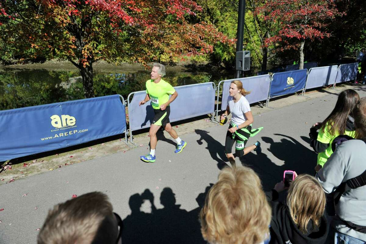 Runners make their way along the bike path as they take part in the Mohawk Hudson Marathon on Sunday, Oct. 12, 2014, in Albany, N.Y. (Paul Buckowski / Times Union)
