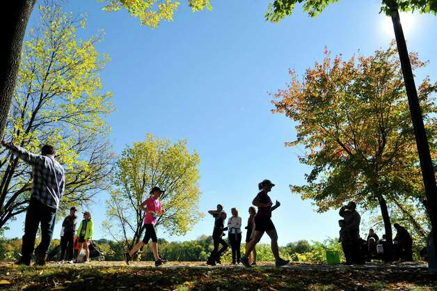 Spectators watch as runners make their way along the bike path as they take part in the Mohawk Hudson Marathon on Sunday, Oct. 12, 2014, in Albany, N.Y.  (Paul Buckowski / Times Union) Photo: Paul Buckowski / 10028957A