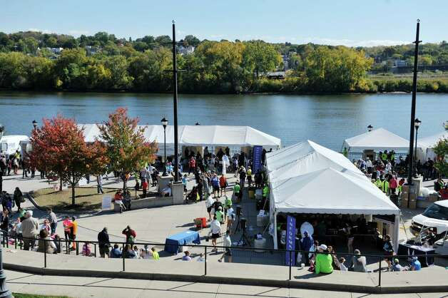 People make their way around to the different vendor's tents at Riverfront Park during the Mohawk Hudson Marathon on Sunday, Oct. 12, 2014, in Albany, N.Y.   (Paul Buckowski / Times Union) Photo: Paul Buckowski / 10028957A