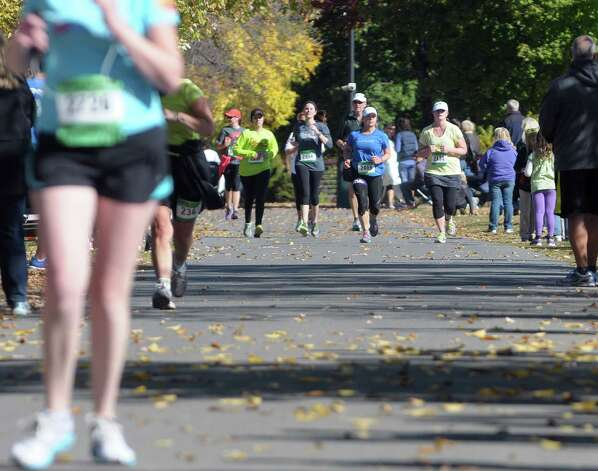 Runners make their way to the finish line in the Mohawk Hudson Marathon on Sunday, Oct. 12, 2014, in Albany, N.Y.   (Paul Buckowski / Times Union) Photo: Paul Buckowski / 10028957A