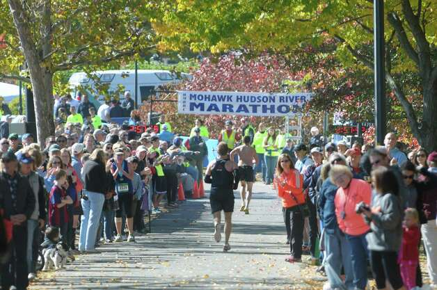 Spectators cheer on runners taking part in the Mohawk Hudson Marathon on Sunday, Oct. 12, 2014, in Albany, N.Y.   (Paul Buckowski / Times Union) Photo: Paul Buckowski / 10028957A