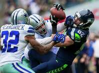 Luke Willson, right, fails to catch a pass during the second half of a game Sunday, October 12, 2014, at CenturyLink Field in Seattle, Washington. The Cowboys beat the Seahawks 30-23.