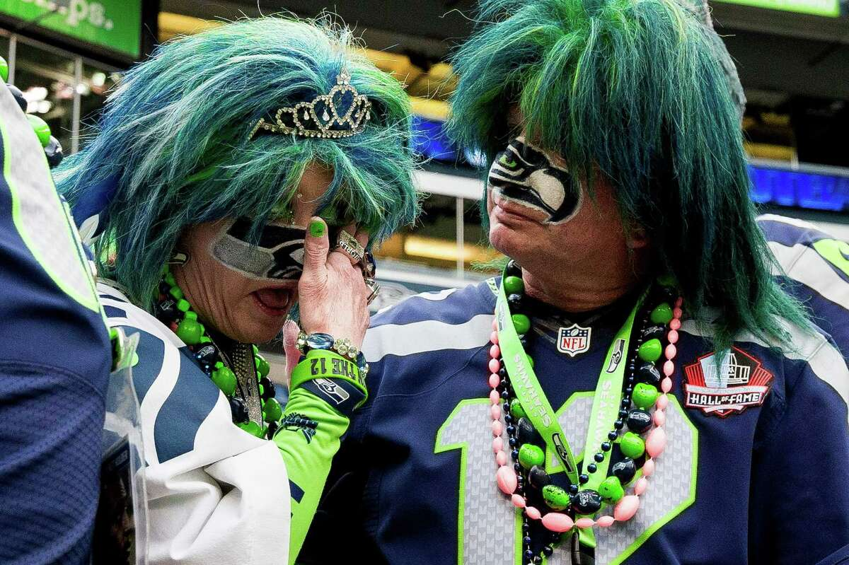 Seahawks superfans shed tears and comfort each other after a 30-23 loss to the Dallas Cowboys.