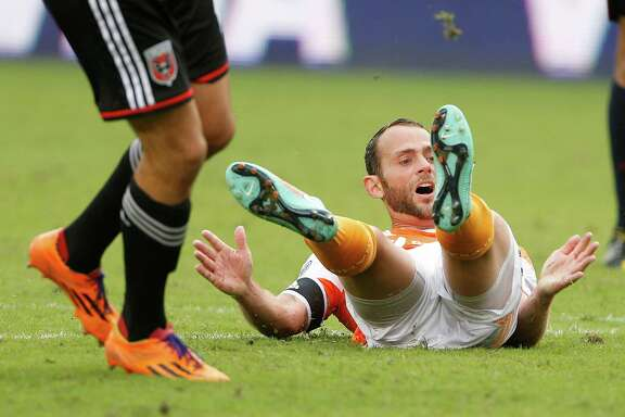 The frustration begins to grow for the Dynamo as midfielder Brad Davis, right, watches his errant shot as the team tries to mount a comeback in the second half Sunday.
