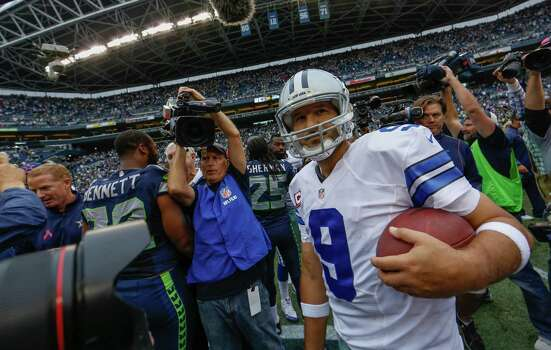 SEATTLE, WA - OCTOBER 12:  Quarterback Tony Romo #9 of the Dallas Cowboys leaves the field after a win over the Seattle Seahawks 30-23 at CenturyLink Field on October 12, 2014 in Seattle, Washington. Photo: Otto Greule Jr, Getty Images / 2014 Getty Images