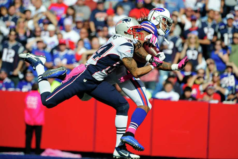 New England Patriots wide receiver Brian Tyms (84) catches a pass for a touchdown as he is defended by Buffalo Bills' Stephon Gilmore (24) during the first half of an NFL football game Sunday, Oct. 12, 2014, in Orchard Park, N.Y. (AP Photo/Gary Wiepert) ORG XMIT: NYFF121 Photo: Gary Wiepert / FR170498 AP
