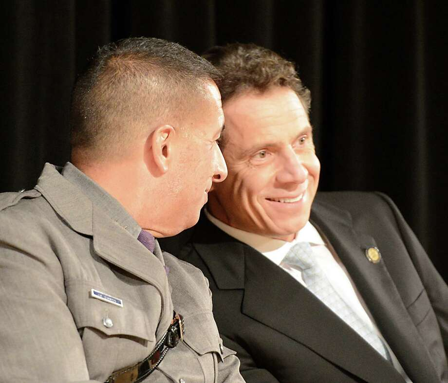 Superintendent Joseph D'Amico, left speaks with Governor Andrew Cuomo at the New York State Police Graduation at the Empire State Plaza Convention Center in Albany, N.Y. Oct 16, 2012.       (Skip Dickstein/Times Union) Photo: Skip Dickstein / 00019675A