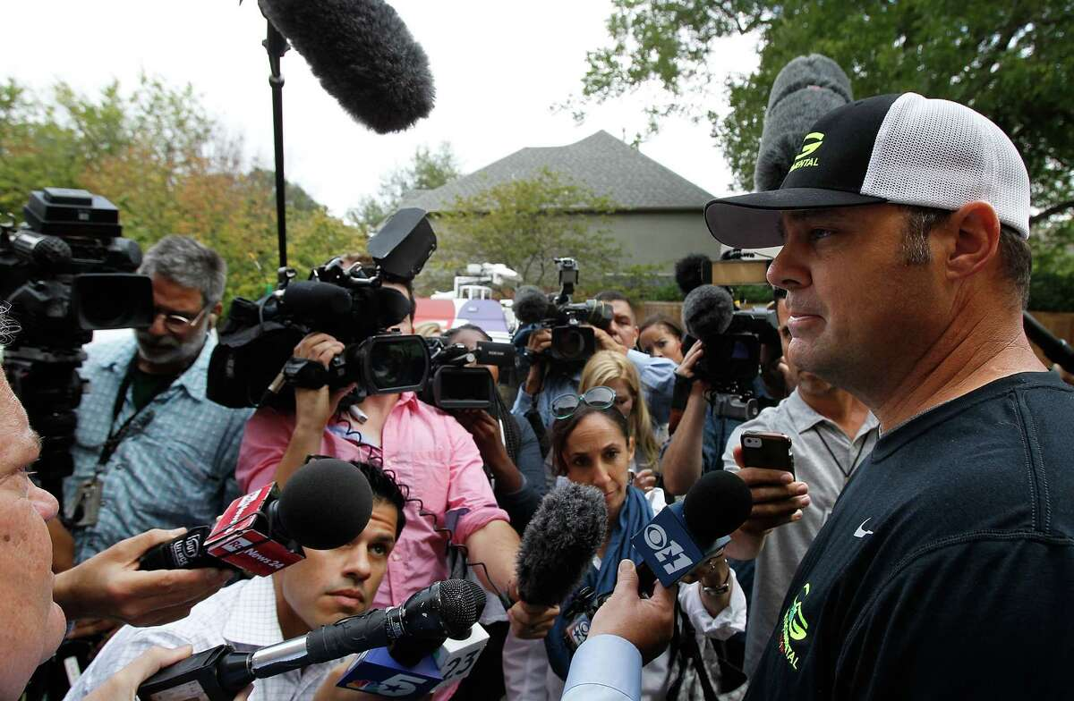 Brad Smith, a hazmat worker, talks with the media outside of the nurse's Dallas apartment. She is the first person to contract Ebola inside the U.S.
