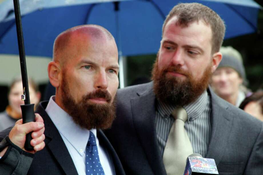 File- This oct. 10, 2014, file photo shows Matthew Hamby, left, and Christopher Shelden speaking during a news conference following a hearing in federal court in Anchorage, Alaska. A federal judge has struck down Alaska's first-in-the-nation ban on gay marriages. U.S. District Judge Timothy Burgess on Sunday, Oct. 12, 2014, said the ban violates the U.S. constitutional guarantee of due process and equal protection. (AP Photo/Mark Thiessen) ORG XMIT: NY111 Photo: Mark Thiessen / AP