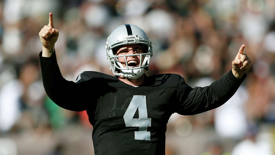 Derek Carr threw four touchdown passes against the Chargers, but also a defeat-sealing interception. Photo: Thearon W. Henderson / Getty Images / 2014 Getty Images