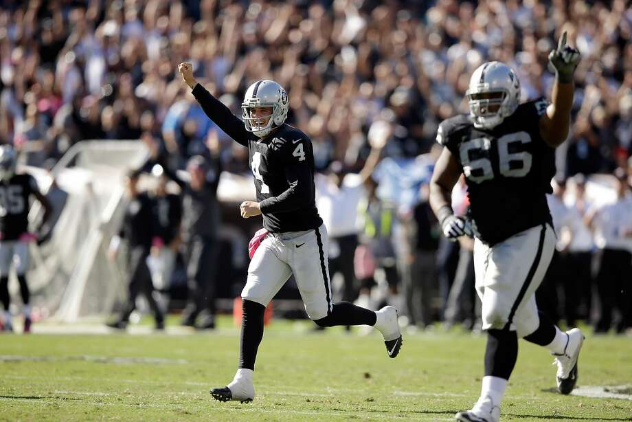 OAKLAND, CA - OCTOBER 12:  Derek Carr #4 and Gabe Jackson #66 of the Oakland Raiders celebrate after Carr threw a touchdown pass to Brice Butler #12 against the San Diego Chargers at O.co Coliseum on October 12, 2014 in Oakland, California.  (Photo by Ezra Shaw/Getty Images) Photo: Ezra Shaw, Getty Images