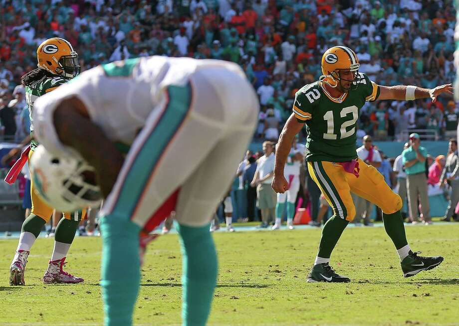 MIAMI GARDENS, FL - OCTOBER 12:  Aaron Rodgers #12 of the Green Bay Packers celebrates the winning touchdown during a game against the Miami Dolphins at Sun Life Stadium on October 12, 2014 in Miami Gardens, Florida.  (Photo by Mike Ehrmann/Getty Images) ORG XMIT: 507866027 Photo: Mike Ehrmann / 2014 Getty Images