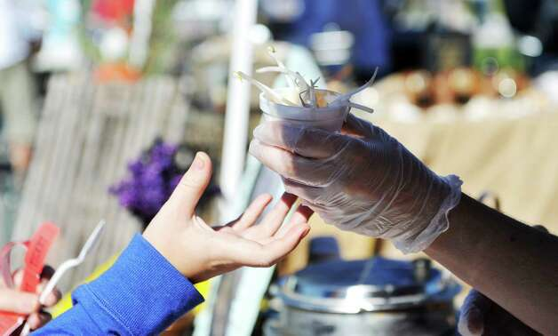 Susan Dunckel, owner of Sweet Sues in Troy, hands a cup of gluten free Thai vegan tom-kha chowder to a visitor at the eighth annual Chowderfest at Riverfront Park on Sunday, Oct. 12, 2014, in Troy, N.Y.   (Paul Buckowski / Times Union) Photo: Paul Buckowski / 00028887A