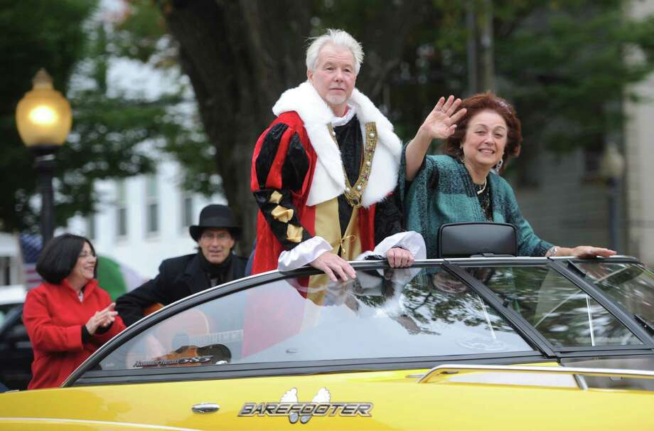 "Rich Zuvich and Gina Clarizio, dressed as Christopher Columbus and Queen Isabella, are towed into P.T. Barnum square on a speedboat during the 32nd annual Columbus Day Parade in Bethel, Conn. Monday, Oct. 13, 2014.  Local musicians Billy and Will Michael played music as folks dressed up as Christopher Columbus and Queen Isabella ""sailed"" in a speedboat, comedically representing Columbus's coming to America in 1492. Photo: Tyler Sizemore / The News-Times"