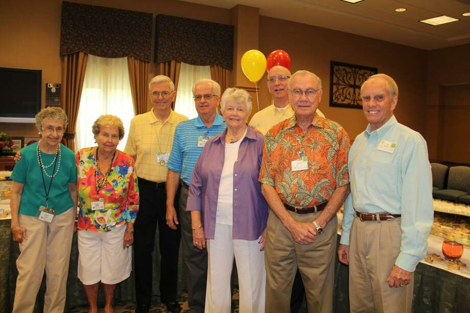 The resident-led dining services committee of Eagle's Trace gathered during the Taste of Eagle's Trace on Aug. 22. Shown left to right are Barbara Hulyk, Kateva LaField, Dan Wagner, Bill Jerram, Mary Jo Lawless, Gerald Lax, Haskell Silkwood and Jay Brooks.