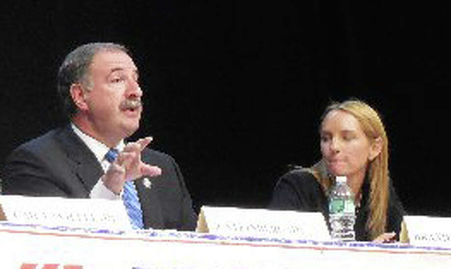 Incumbent Democrat Jonathan Steinberg, left, and his Republican challenger Brandi Briggs face off at noon Tuesdayat the Westport Library in a forum for candidates in the 136th House District. The program is sponsored by the Westport Weston Chamber of Commerce. Photo: Anne Amato / Westport News