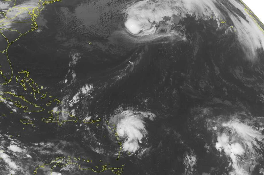 This NOAA satellite image taken Monday, Oct, 13, 2014, at 01:45 AM EDT shows Tropical Storm Gonzalo over the Antilles producing strong winds, thunderstorms and heavy rain. A few more thunderstorms have developed over Hispaniola and the southern Bahamas as well from the tropical flow. Photo: NOAA Via Weather Underground, AP / NOAA via Weather Underground