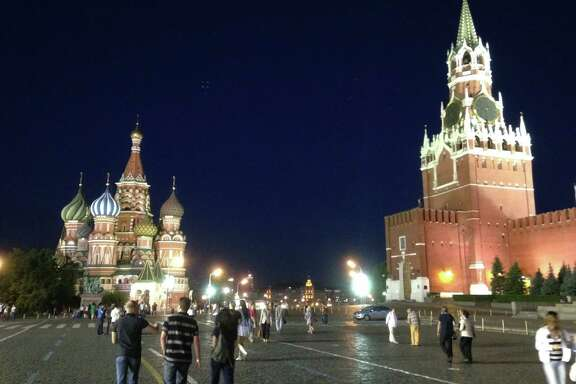 St. Basil's Cathedral and the Saviour's Tower at night on the Red Square in Moscow.