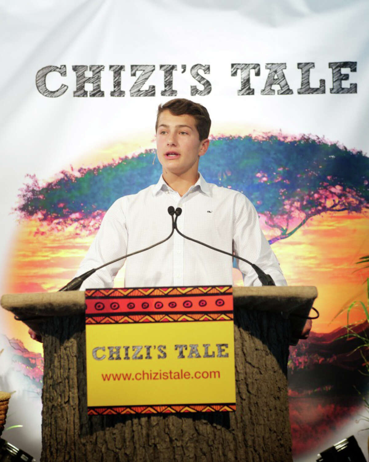 """Greenwich's Jack Jones recently published his first children's book, """"Chizi's Tale,"""" which tells a true tale of a family's decision to keep an abandoned black rhino in their home. Here, he talks about the project at a book launch in September 2014."""