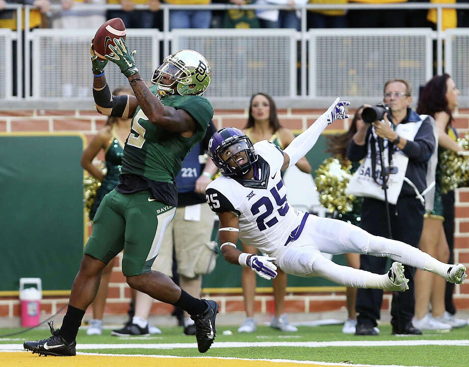 Baylor and TCU enter 2015 ranked in the nation's top five after stellar 2014 seasons. Click through the gallery to see how Texas schools ranked in the preseason top 25 have fared since the start of the BCS era. Photo: Jerry Larson, Associated Press / The Waco Tribune Herald