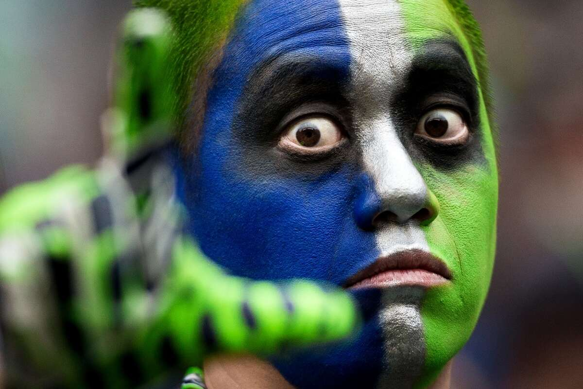 Seahawks fans: Exactly how many King Beers does it take to turn friendly painted face man into a