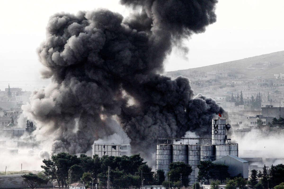 Heavy smoke rises following an air strike by U.S.-led coalition aircraft in Kobani, Syria.