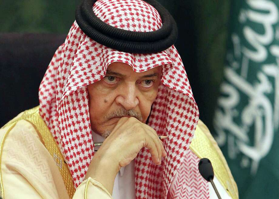 "Saudi Foreign Minister Prince Saud al-Faisal looks on during a press conference with the German Foreign Minister Frank-Walter Steinmeier (unseen) following their meeting in the coastal City of Jeddah, on October 13, 2014. Iran must withdraw its ""occupying"" forces from Syria to help resolve that country's conflict, Saudi Foreign Minister Prince Saud al-Faisal said after talks with his German counterpart. Photo: STR / AFP/Getty Images / AFP"
