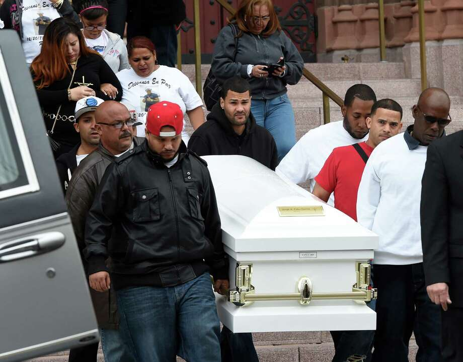 The casket carrying the remains of Jorge A. Falu-Garcia leaves the Cathedral of the Immaculate Conception after a funeral ceremony Monday, Oct. 13, 2014, in Albany, N.Y.  Falu-Garcia was shot and killed October 2nd on 1st Street in Albany.   (Skip Dickstein/Times Union) Photo: SKIP DICKSTEIN / 10028970A