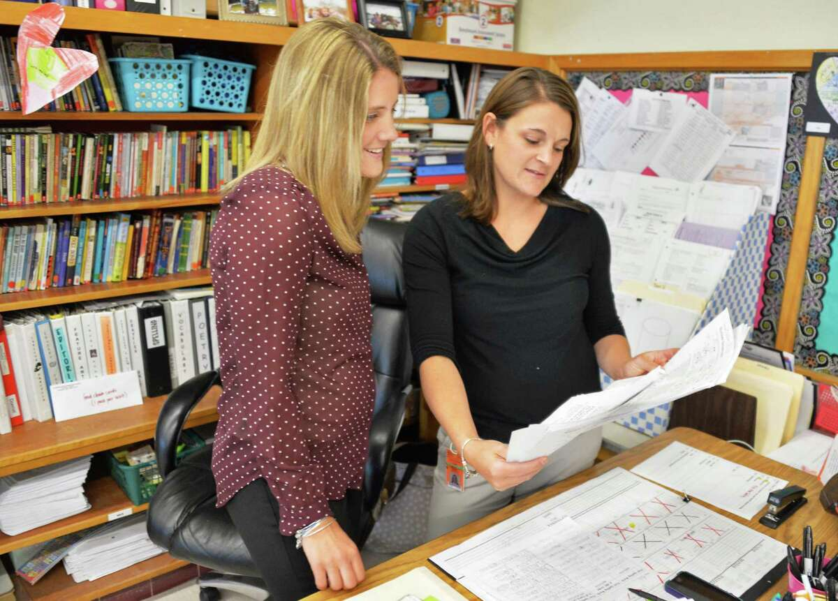 Job sharing teachers Stefanie Doemel, left, and Kelly Ward in their fourth grader classroom at Slingerlands Elementary School Tuesday Sept. 30, 2014, in Delmar, NY. (John Carl D'Annibale / Times Union)