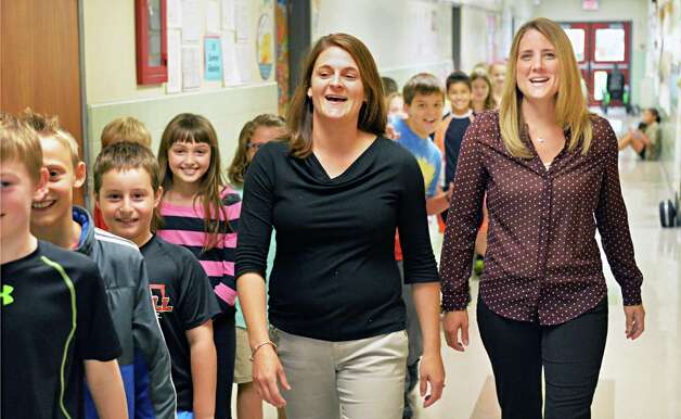 Job sharing teachers Kelly Ward center left, and Stefanie Doemel walk their fourth graders to lunch at Slingerlands Elementary School Tuesday Sept. 30, 2014, in Delmar, NY.   (John Carl D'Annibale / Times Union) Photo: John Carl D'Annibale / 10028781A