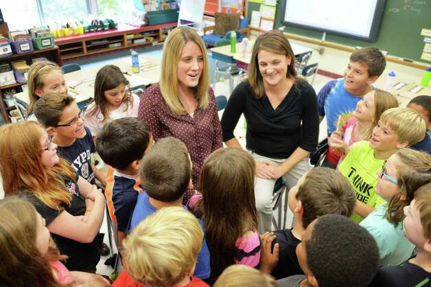 Job sharing teachers Stefanie Doemel, center left, and Kelly Ward with their fourth graders at Slingerlands Elementary School Tuesday Sept. 30, 2014, in Delmar, NY.   (John Carl D'Annibale / Times Union) Photo: John Carl D'Annibale / 10028781A