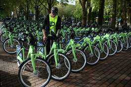 Bikes are readied for use as Pronto Cycle Share launches a bike share program in Seattle on Monday, October 13, 2014. The program will have 500 bicycles available for rent at 50 stations mostly in the core of Seattle.