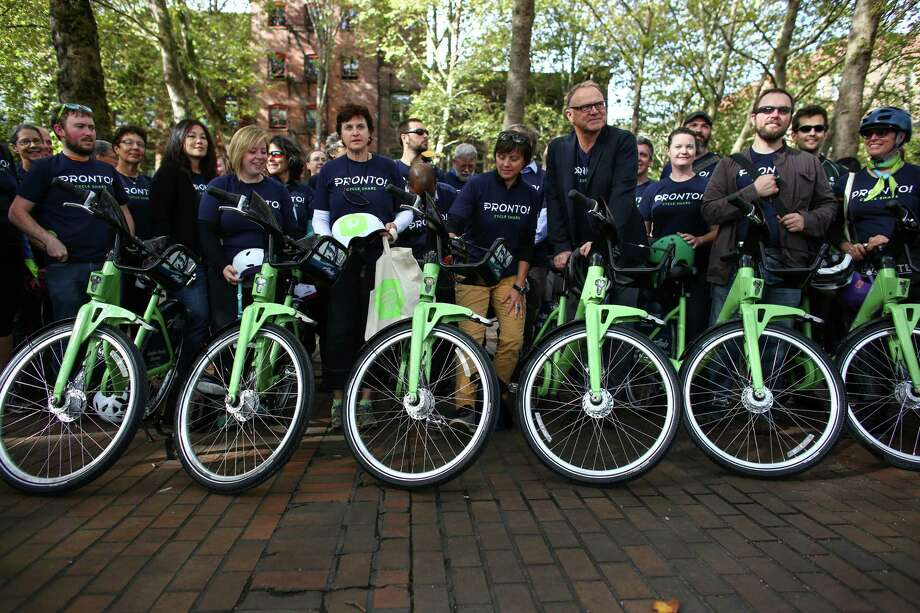 Seattle's Pronto bike share program will end its two and a half year run this Friday just before midnight. The program has seen dismal membership numbers and cost the city more than $2.2. million.Pictured: Riders pose with their wheels for a group photo as Pronto Cycle Share launches a bike share program in Seattle on Monday, October 13, 2014. The program will have 500 bicycles available for rent at 50 stations mostly in the core of Seattle. Photo: JOSHUA TRUJILLO, SEATTLEPI.COM / SEATTLEPI.COM