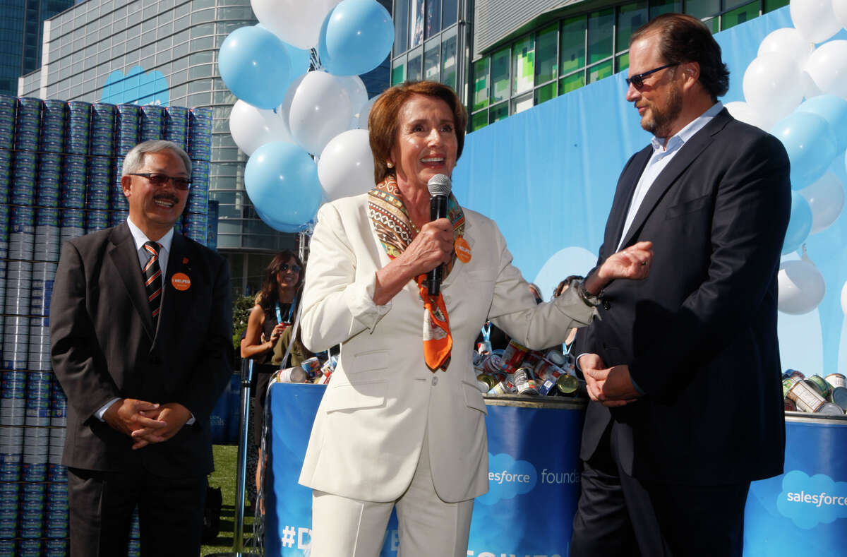 House Minority Leader Nancy Nancy Pelosi rallies support for the food drive along with Mayor Ed Lee (left) and Salesforce.com CEO Marc Benioff at the opening of the Dreamforce conference.