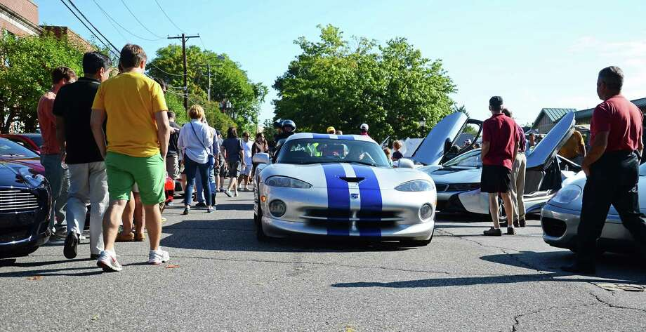 Hundreds of unique cars roll into downtown New Canaan, Conn., during Caffeine & Carburetors Sept. 7, 2014. For the first time this Sunday, Oct. 19, the increasingly popular event will be taking place at Waveny Park. Photo: Nelson Oliveira / New Canaan News