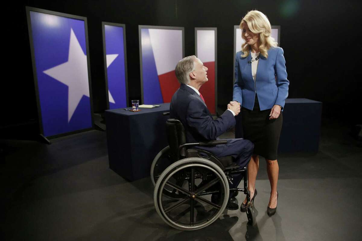 Texas State Sen. Wendy Davis, right, Democratic candidate, and Texas Attorney General Greg Abbott, Republican candidate, shake hands before the final gubernatorial debate in a KERA-TV studio in Dallas on Tuesday, Sept. 30, 2014. (Andy Jacobsohn/Dallas Morning News/MCT)
