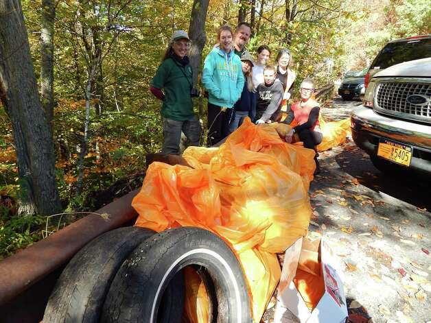 Eight volunteers worked alongside Department of Environmental Conservation staff to pick up litter in the Kaaterskill Falls area on Sunday, Oct. 5. The event was organized by the Catskill Conservation Corps. They filled more than a dozen large garbage bags full of trash before hauling them, along with several tires and other large, discarded items, up steep slopes for removal and disposal. (Georgette Weir)