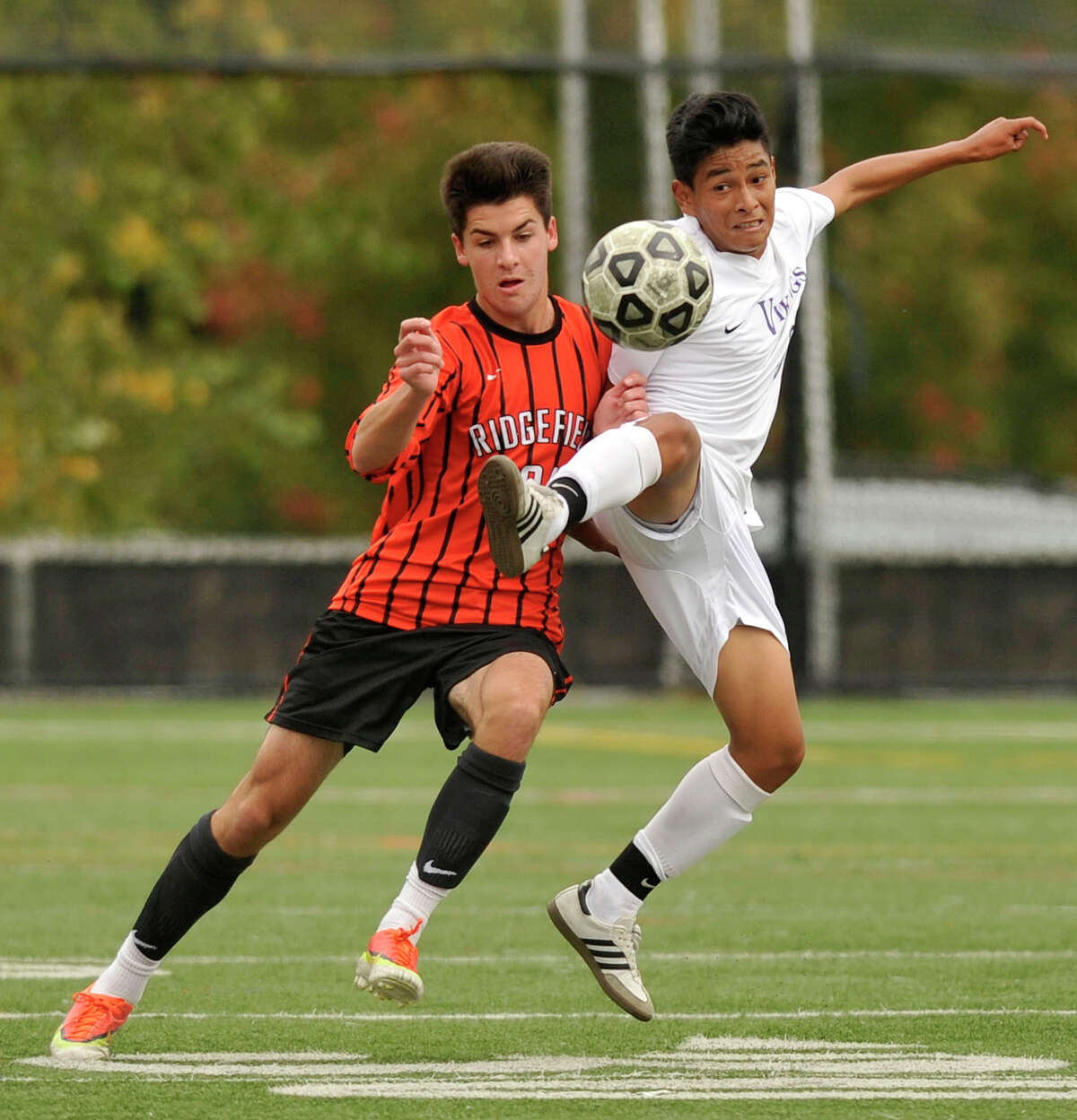 Ridgefield's Andrew Papa and Westhill's Hector Cruz compete for the loose ball during their soccer game at Westhill High School in Stamford, Conn., on Monday, Oct. 13, 2014. Ridgefield and Westhill played to a 2-2 tie.