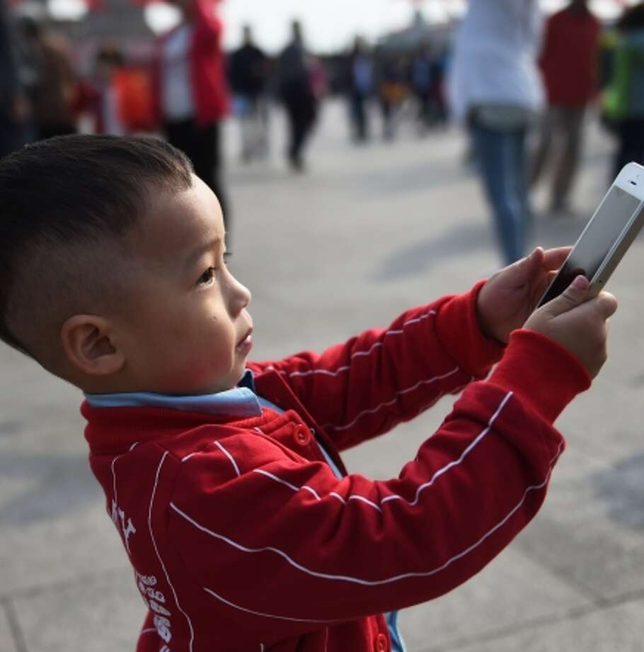 The latest iPhones will be released in China on Friday. Photo: GREG BAKER / AFP/Getty Images / AFP