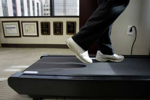 Some experts say treadmill desks  help with weight loss and productivity.