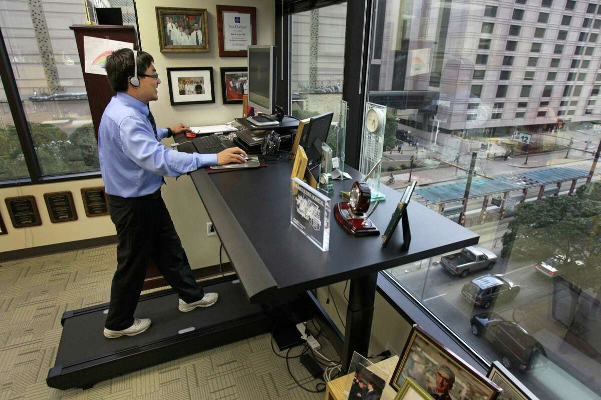 Dr. Andrew Lee, chair of the Department of Ophthalmology at The Methodist Hospital, uses his office treadmill desk, walking 2 to 4 miles a day.
