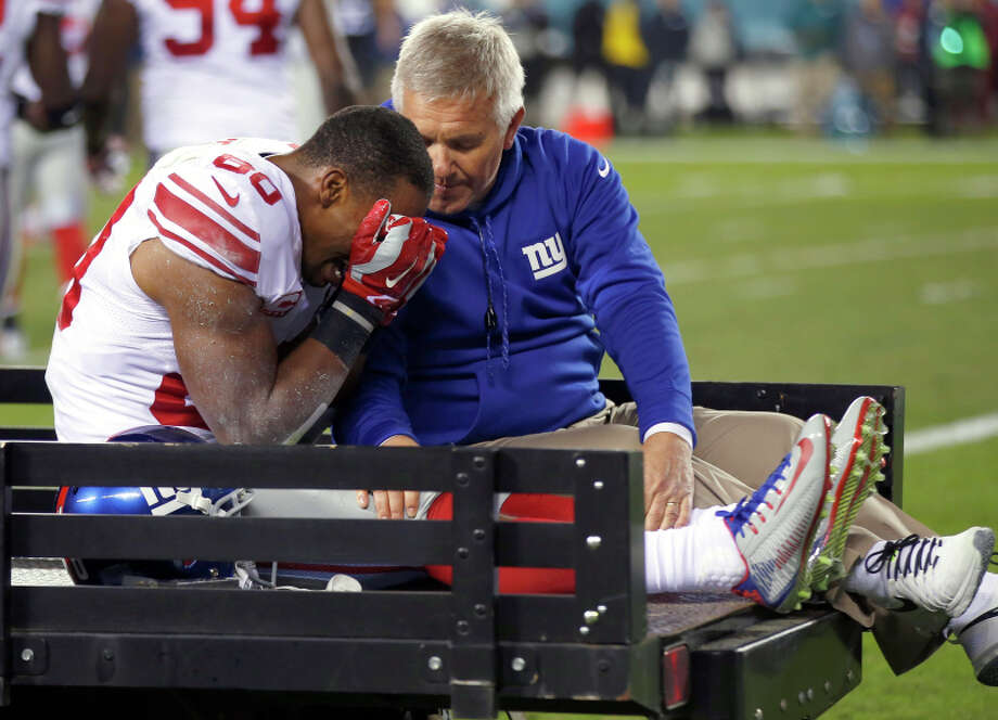Victor Cruz leaves the field on a cart after tearing a knee tendon in the third quarter Sunday night. Photo: Matt Rourke / Associated Press / AP