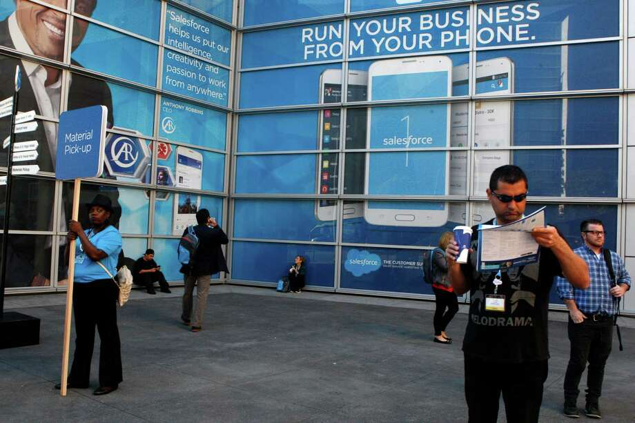 Attendees wait during the start of Dreamforce 2014 in San Francisco, Calif., on Monday, October 13, 2014. Photo: Liz Hafalia / The Chronicle / ONLINE_YES